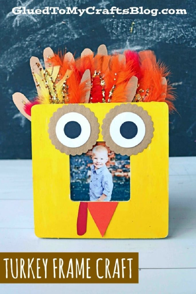 turkey frame craft made of construction paper and handprints with feathers
