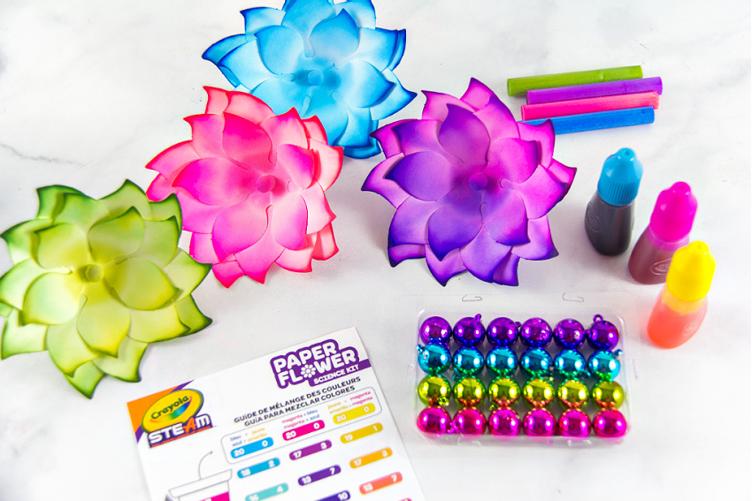 color changing paper flowers dyed to match Christmas baubles to make a wreath