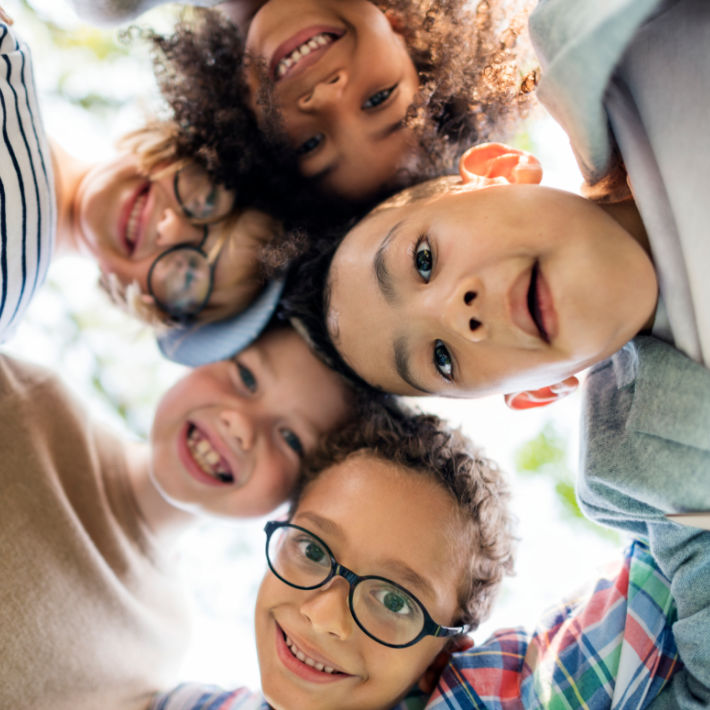 Over 4800 Kids Activities and ways to keep kids entertained from Kids Activities Blog - kids playing and looking down at camera