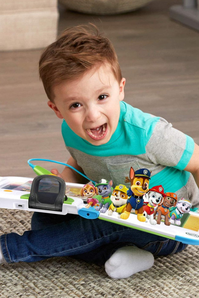 a little boy is excited to see the 3d paw patrol characters on his leapfrog leapstart. It features books with animated characters to make learning fun!