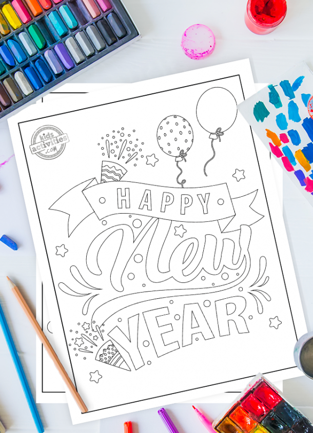 Happy New Year coloring page styled as a banner with balloons confetti horns stars and sparkles on top of another coloring page on a desktop surrounded by coloring supplies like pastels, pencils and paint.