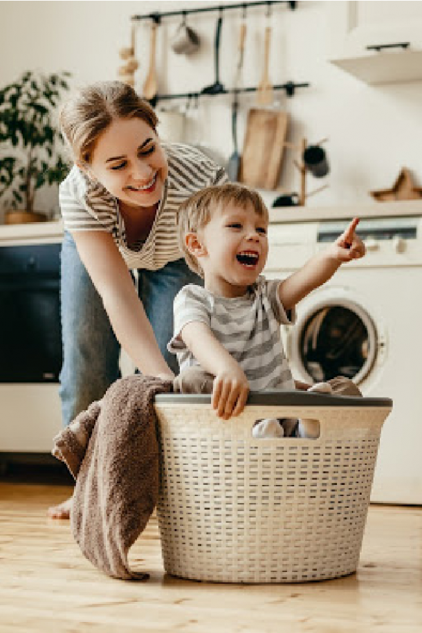 Makes extra space in your house by organizing which is what this mom is doing with her son in a basket.