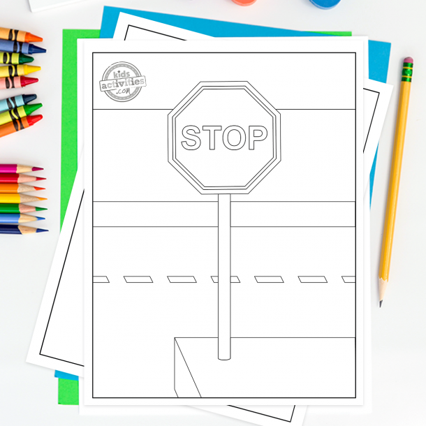 safety signs coloring pages  - shown is a road sign coloring page that has been printed out - this has a stop sign on a post on a street with colored pencils to the side