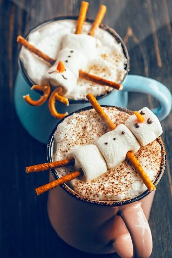 marshmallow snowman floating in hot chocolate - Kids Activities Blog