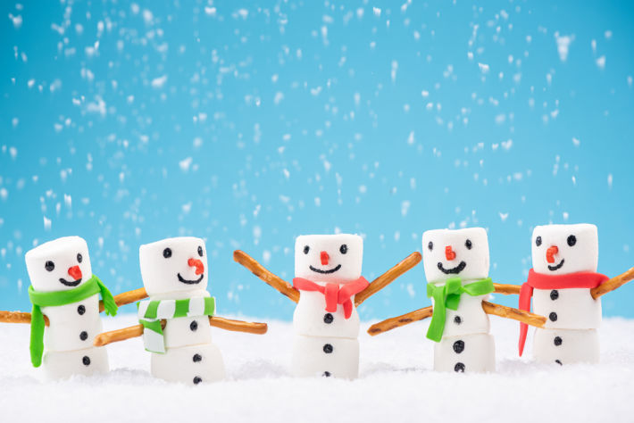 Marshmallow snowman that have candy cane noses and strip candy scarves - Kids Activities Blog