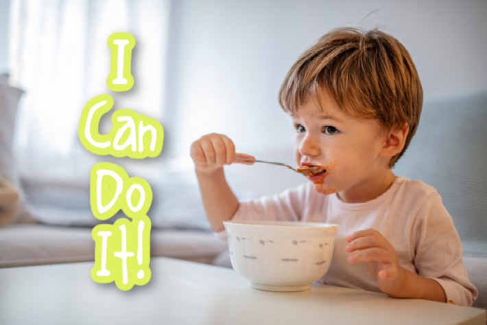 18 month old fine motor skill activities - skill level of feeding himself with a spoon - I can do it - child feeding himself - Kids Activities Blog