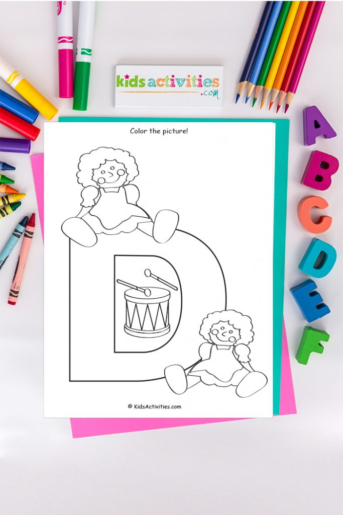 Letter D coloring page from Kids Activities Blog - color the picture - capital letter D with two dolls and a drum on a background with abc's and crayons, markers