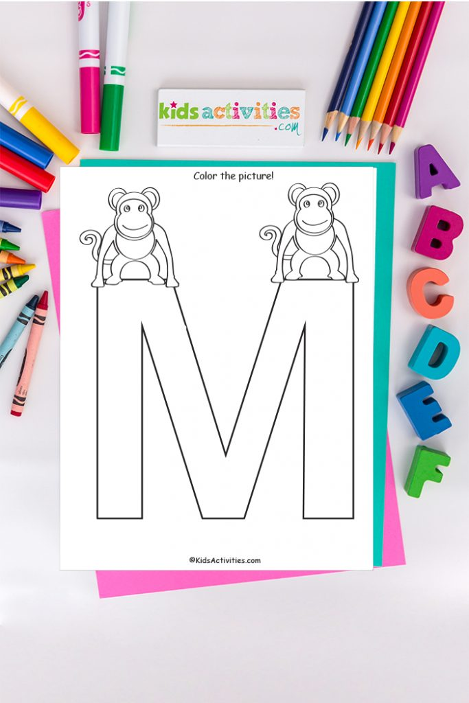 letter m coloring page - Kids Activities Blog - capital M with two monkeys on background of ABC's crayons and markers