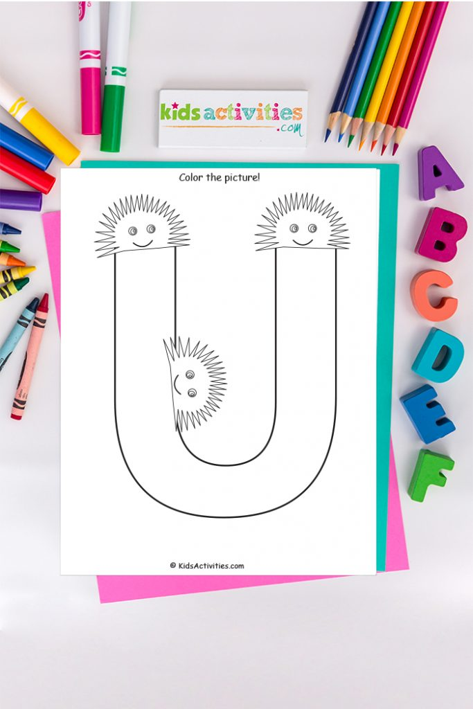 Letter U coloring page Kids Activities Blog - color the picture of the capital letter U surrounded by three urchins on a background of ABCs and crayons colored pencils and markers