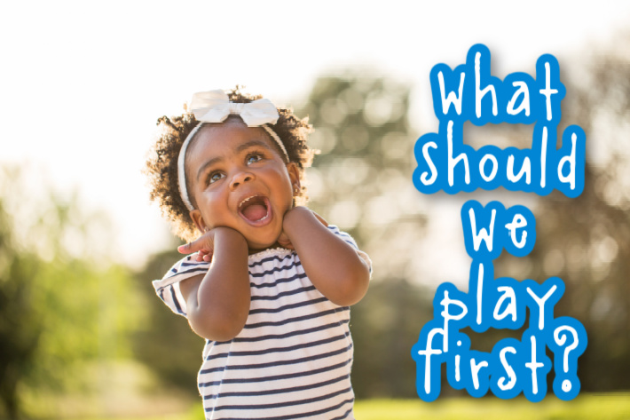 activities for one year olds - what should we play first? Kids Activities Blog - 1 year old girl outside laughing and playing activities