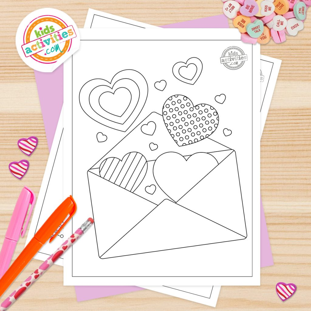 printable valentines day heart coloring pages shown on desk with markers, pencil and conversation heart candies