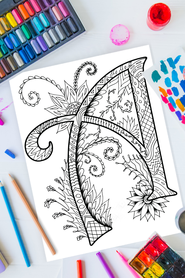Zentangle alphabet coloring pages - letter a zentangle design on background of paint, colored pencils and art supplies