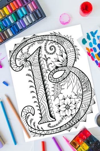 Zentangle alphabet coloring pages - letter b zentangle design on background of paint, colored pencils and art supplies