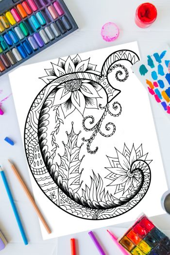 Zentangle alphabet coloring pages - letter c zentangle design on background of paint, colored pencils and art supplies