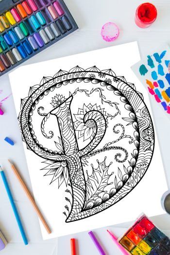 Zentangle alphabet coloring pages - letter d zentangle design on background of paint, colored pencils and art supplies