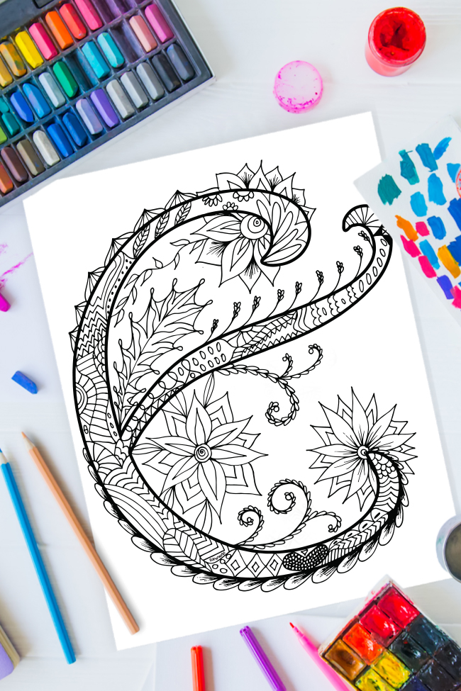 Zentangle alphabet coloring pages - letter e zentangle design on background of paint, colored pencils and art supplies