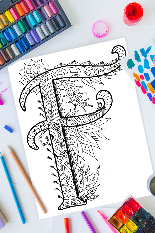 Zentangle alphabet coloring pages - letter f zentangle design on background of paint, colored pencils and art supplies