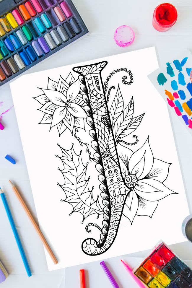 Zentangle alphabet coloring pages - letter j zentangle design on background of paint, colored pencils and art supplies