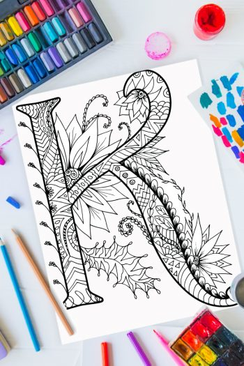 Zentangle alphabet coloring pages - letter k zentangle design on background of paint, colored pencils and art supplies