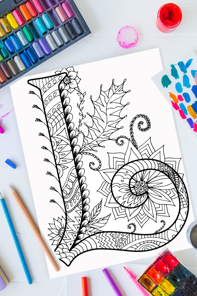 Zentangle alphabet coloring pages - letter l zentangle design on background of paint, colored pencils and art supplies
