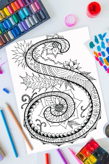 Zentangle alphabet coloring pages - letter s zentangle design on background of paint, colored pencils and art supplies