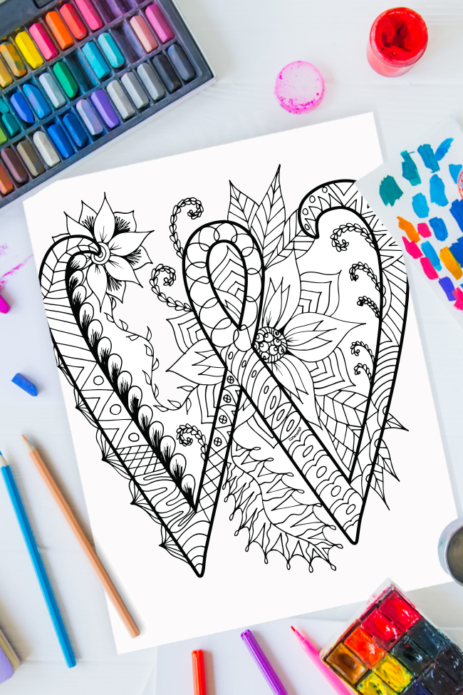 Zentangle alphabet coloring pages - letter w zentangle design on background of paint, colored pencils and art supplies