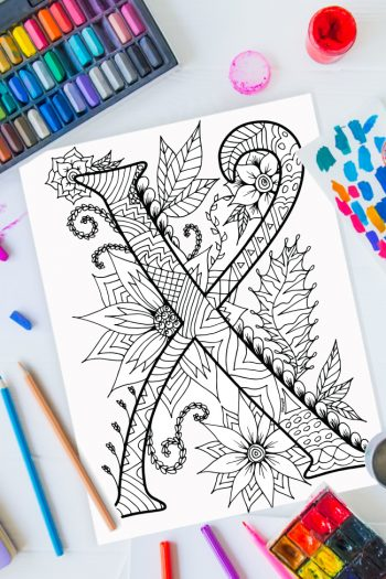 Zentangle alphabet coloring pages - letter x zentangle design on background of paint, colored pencils and art supplies
