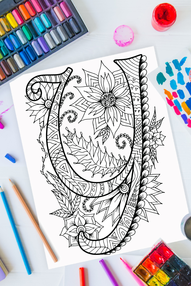 Zentangle alphabet coloring pages - letter y zentangle design on background of paint, colored pencils and art supplies