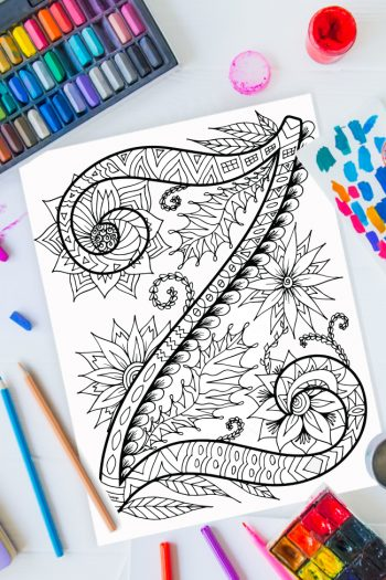 Zentangle alphabet coloring pages - letter z zentangle design on background of paint, colored pencils and art supplies