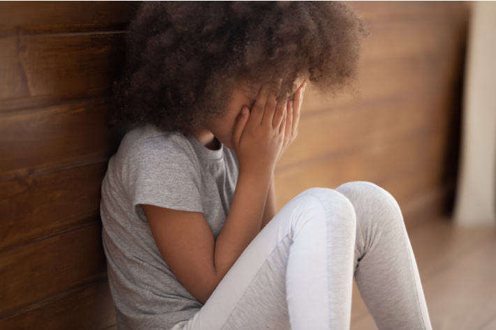 How to Be More Patient with Your Kids - middle school age girl upset and sitting in corner