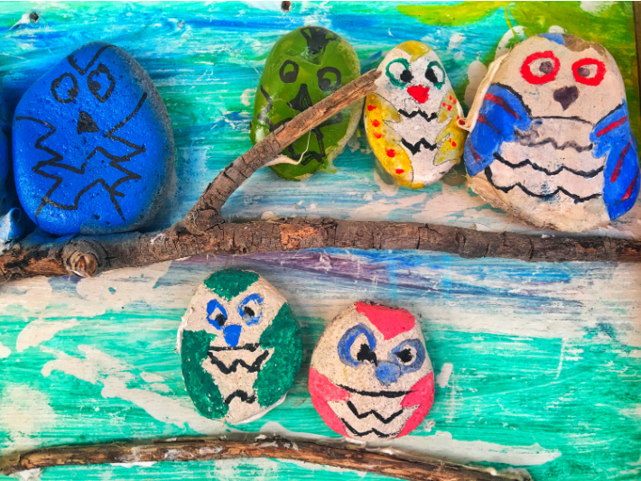 Easy rock painting ideas for kids - owl family - 5 painted rocks of different types of owl birds with brightly colored paint and markers.