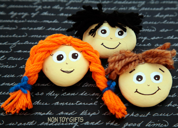 Cute people painted rocks with big painted eyes and yarn hair from Non Toy Gifts website.
