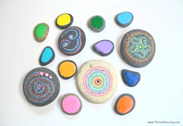 Colorful painted rocks that have dots and patterns from Color Made Happy
