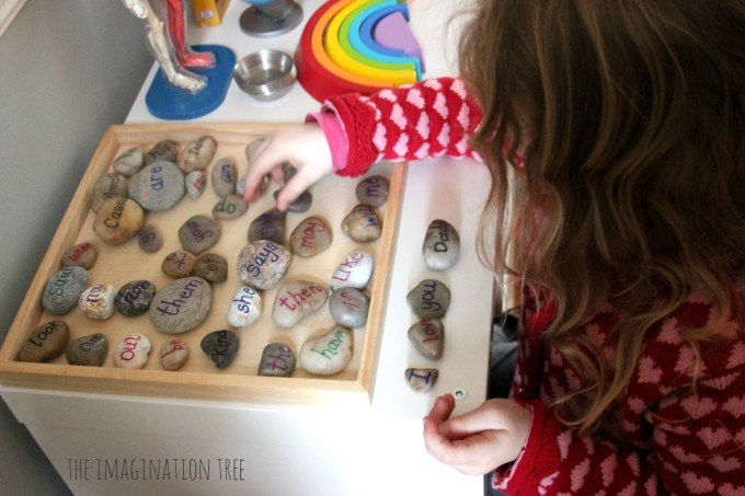 painted rocks with sight words and other words so kids can make stone sentences from The Imagination Tree