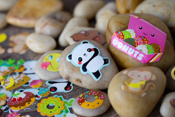 Sticker decorated rocks from Fireflies and Mudpies - shown are a panda, donut box and flowers on rocks