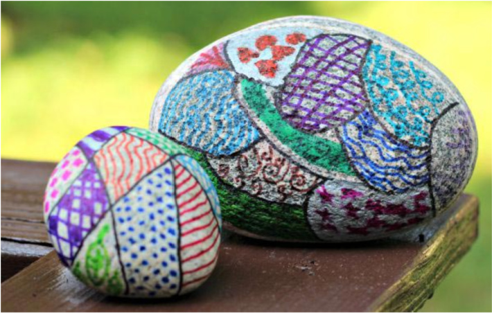 Zentangle painted rocks idea from KC Edventures site - beautiful zentangle designs on two rocks one big and one small