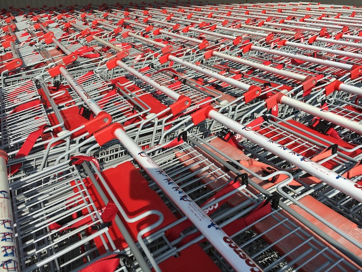 Costco Warehouse carts all lined up outside store ready for shoppers to pick up those good Costco deals