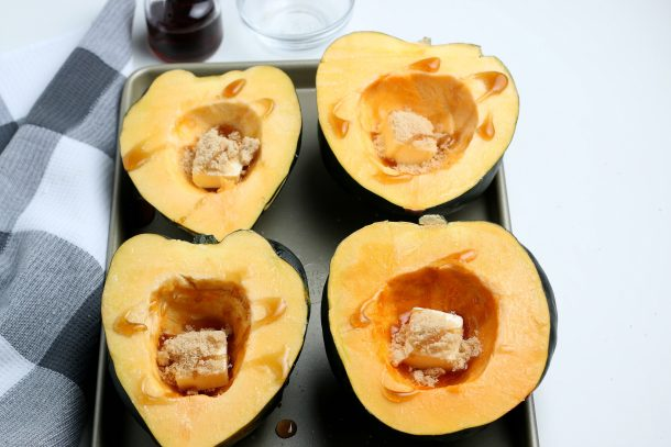The Best Roasted Acorn Squash Recipe - Step drizzle maple syrup on each half of squash