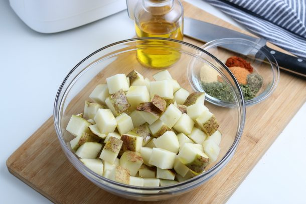 Air Fryer Diced Potatoes - Step Place diced potatoes into bowl