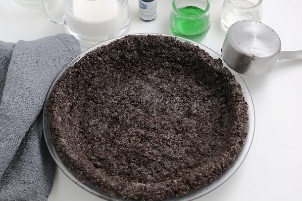 The Best Grasshopper Pie Recipe - Step press the crust mixture into a greased pie plate