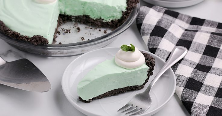 The Best Grasshoppe Pie Recipe - a slice of creamy grasshopper pie, with whipped cream topping