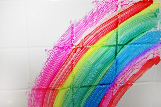bathtub tile shown painted with homemade bath paint in the colors of a rainbow