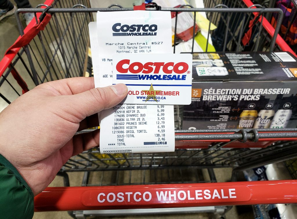 Costco Wholesale membership card and cart with receipt for sale items and regularly priced items