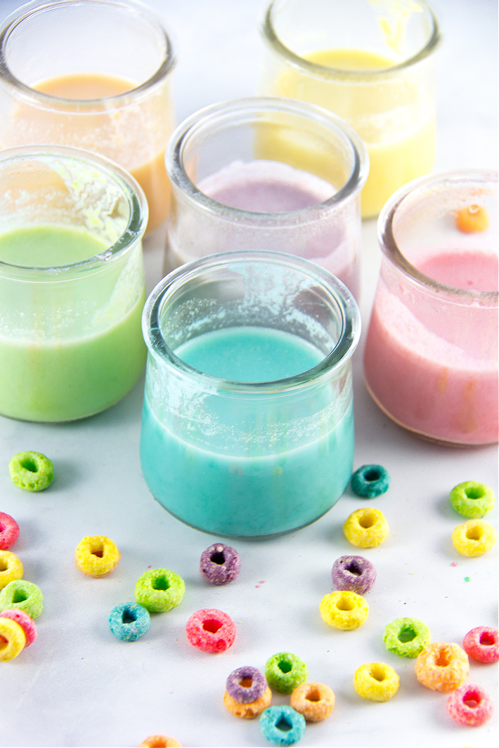 homemade paint in small yogurt jars made out of fruit loops