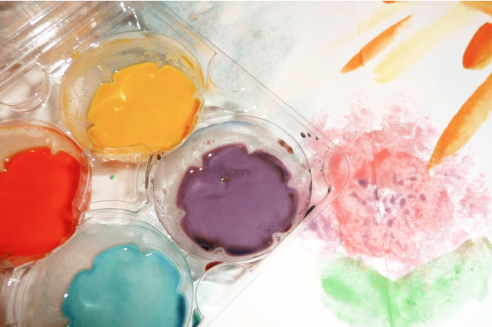 homemade watercolor paint recipe for kids - shown in an egg carton with a painted flower