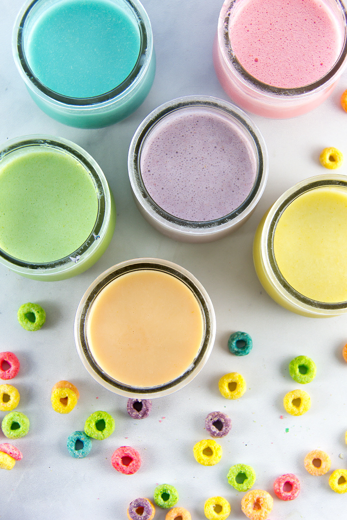 small yogurt jars filled with homemade paint made out of Fruit Loops and yogurt