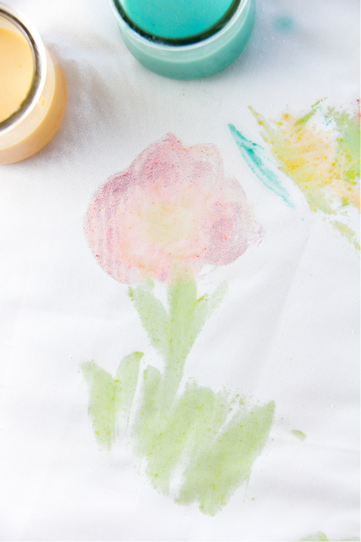 A flower painted on a sheet with Fruit Loops paint