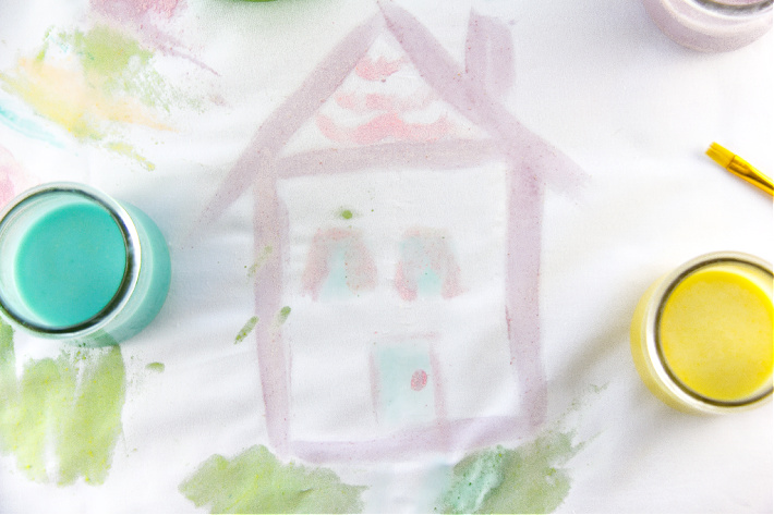 painting a house on fabric with homemade edible fruit loops paint