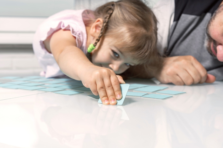 Playing the game of memory on the floor - Kids Activities Blog