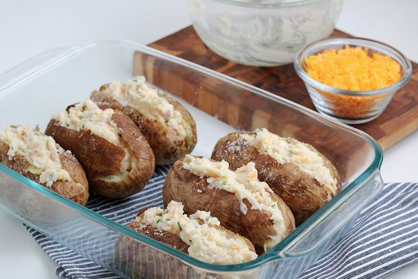 Easy Twice Baked Potatoes Recipe - Stepsprinkle cheese on top of potatoes